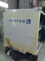 United baggage cart in daytime